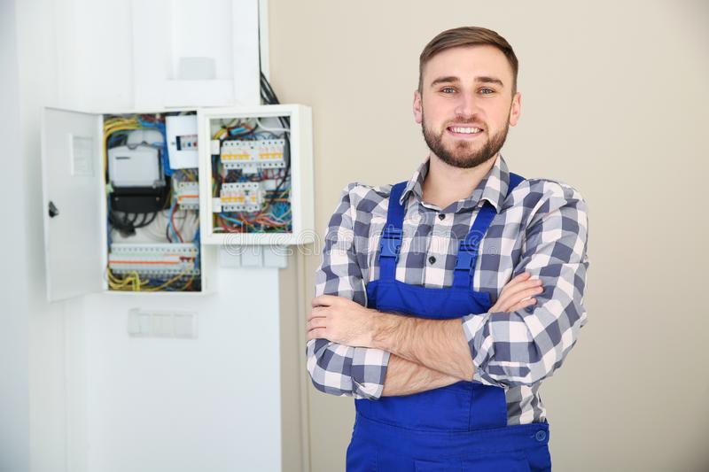 Male electrician standing near fuse board royalty free stock photos