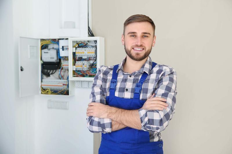 Male electrician standing near fuse board royalty free stock images