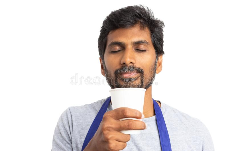 Male employee close-up as smelling coffee stock image