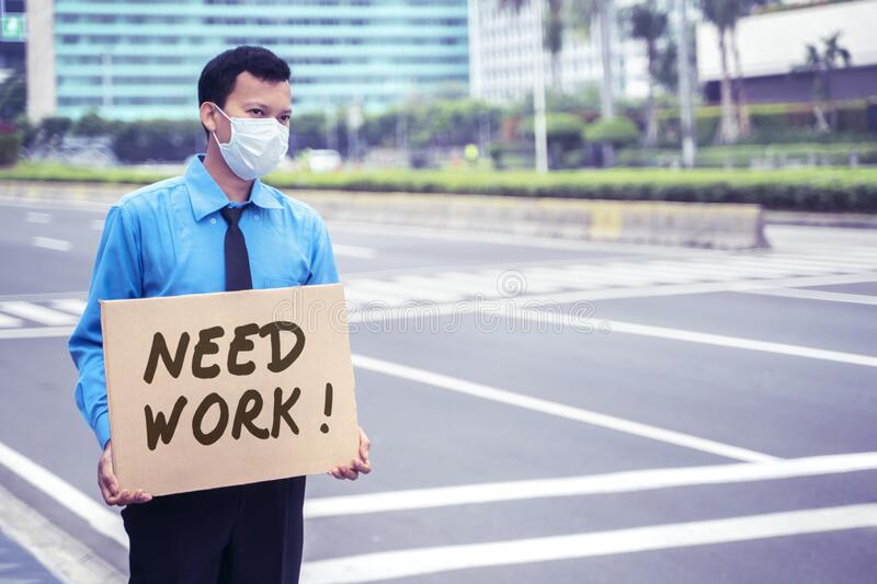 Male employee holds text of need work on sidewalk stock photos