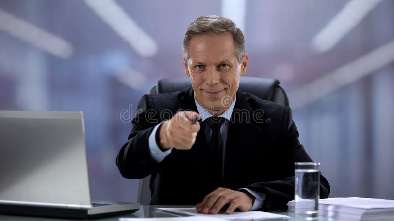 Male employer pointing pen at camera, successful job interview result employment stock image