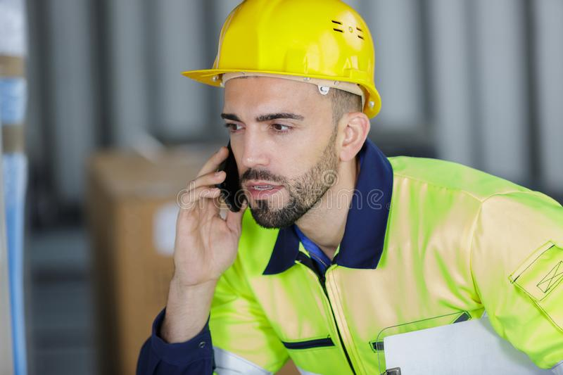 Male engineer check oil refinery phone talk concept royalty free stock photo
