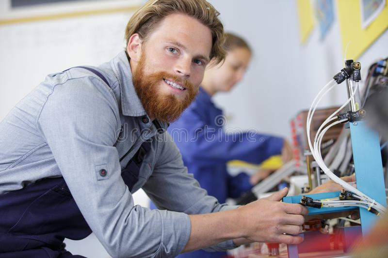 Male engineer checking electrical system royalty free stock images