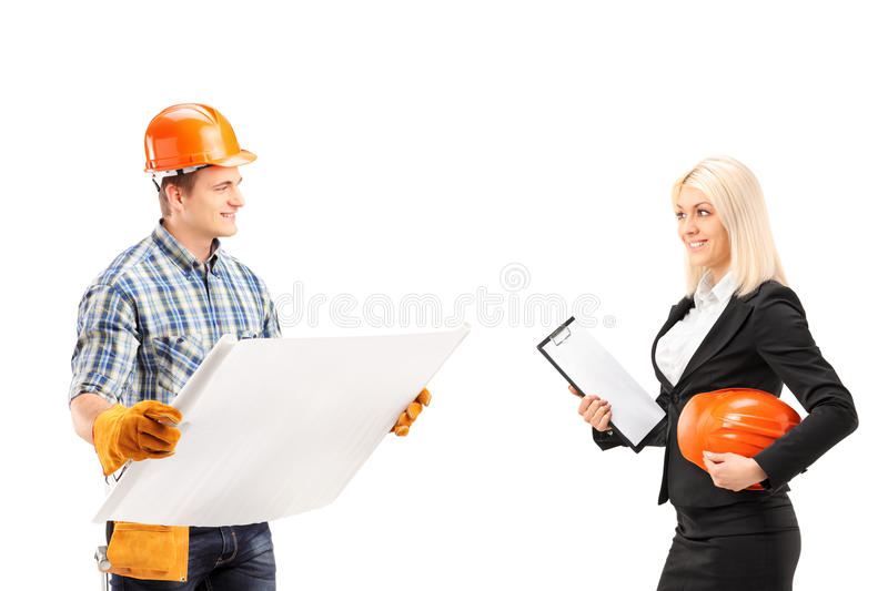 Male Engineer Holding A Blueprint And Discuss With Female Archit Royalty Free Stock Image