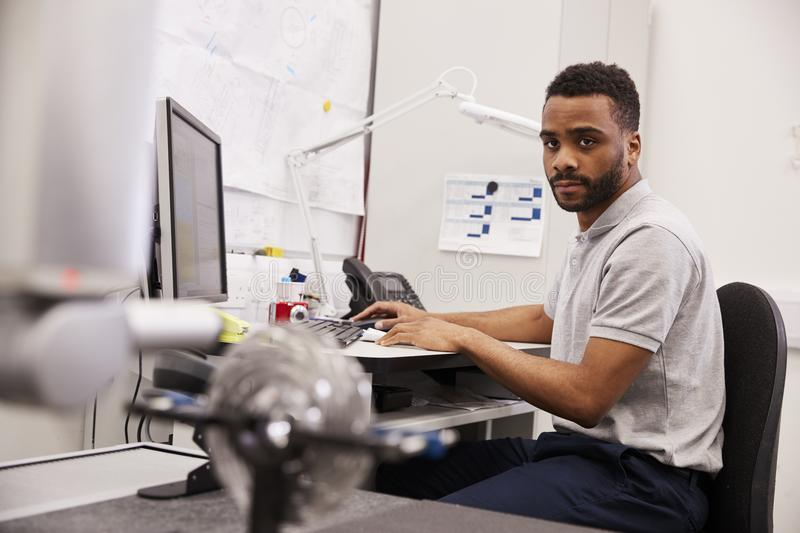 Male Engineer Uses CMM Coordinate Measuring Machine In Factory stock images