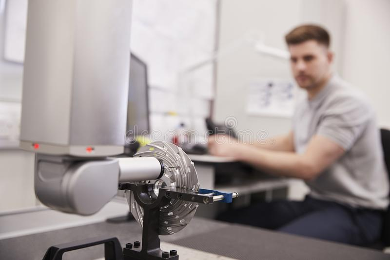 Male Engineer Uses CMM Coordinate Measuring Machine In Factory royalty free stock images
