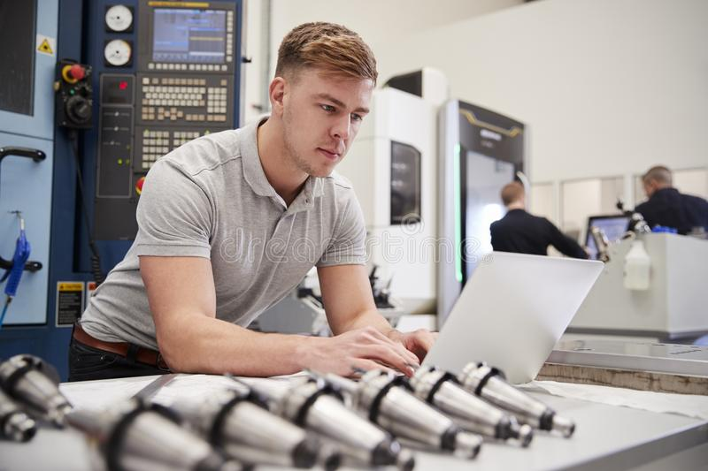Male Engineer Using CAD Programming Software On Laptop royalty free stock images