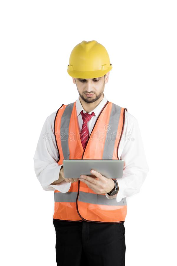 Engineer using tablet computer in studio royalty free stock photography