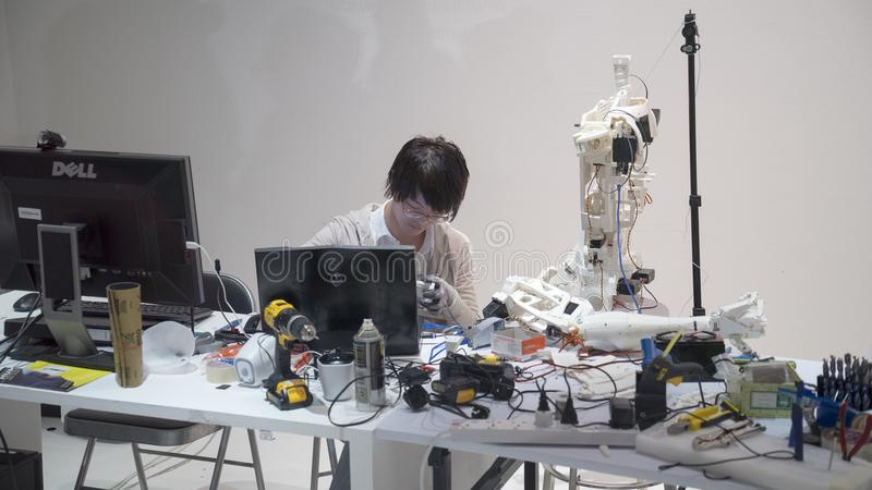 Male engineer working on robotics project royalty free stock images