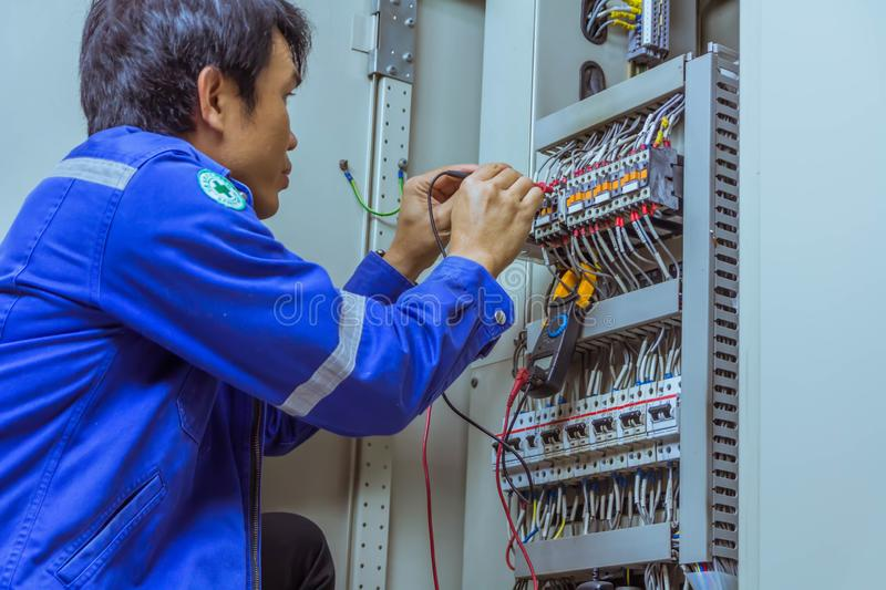 Male engineers are checking the electrical system with electronic tools, clamp-on, clip amp ,clamp meter stock images