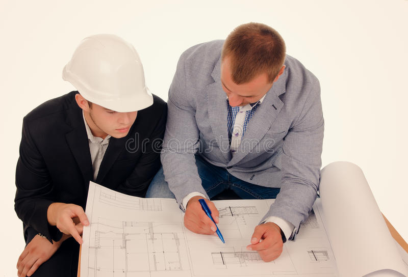 Male Engineers Discussing Design from Blueprint stock photos