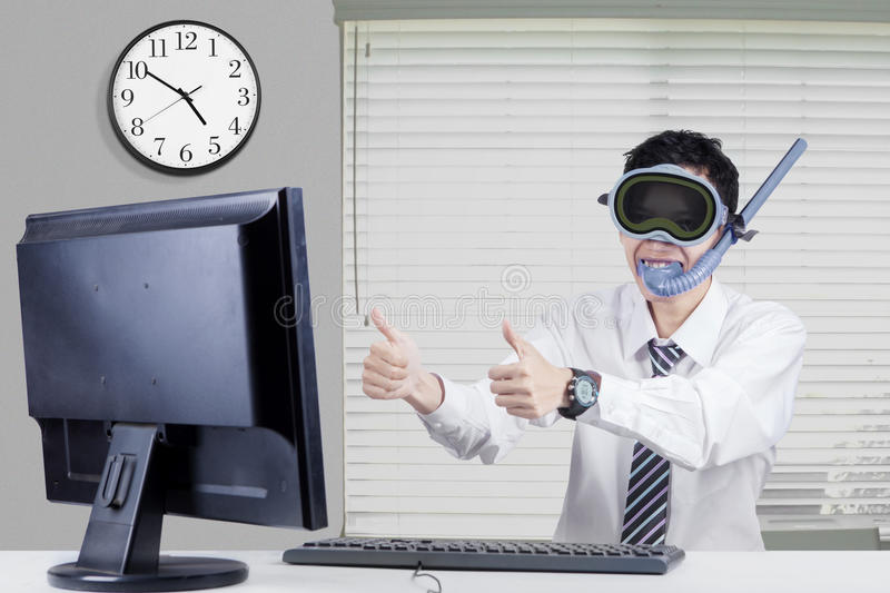 Male entrepreneur with goggles and snorkel royalty free stock photography