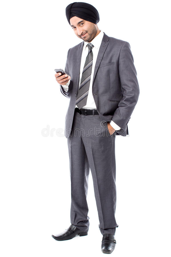 Download Male Executive Sending Text Message Stock Photo - Image: 34104850