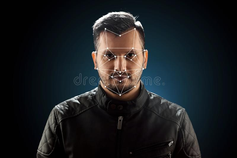 Male face, Biometric verification face recognition. Technology of face recognition on polygonal grid is constructed by royalty free stock image