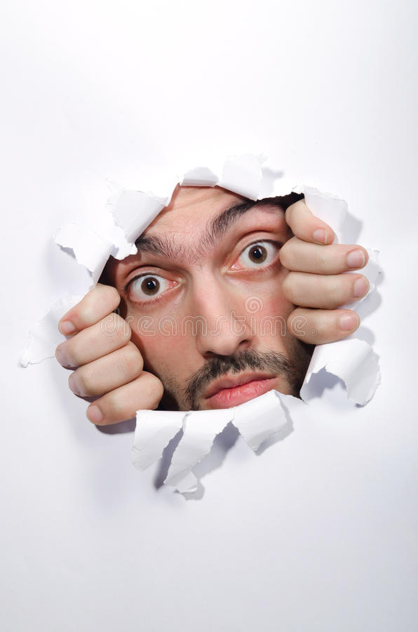 Download Male face through the hole stock photo. Image of make - 26272198