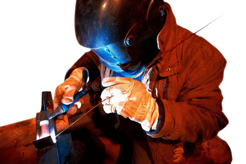 Male in face mask welds with argon-arc. Welding royalty free stock images