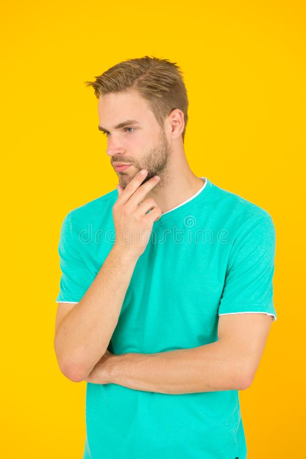 Male facial care. having perfect look. sexy man beard yellow background. unshaven man express positivity. he has stylish royalty free stock photography