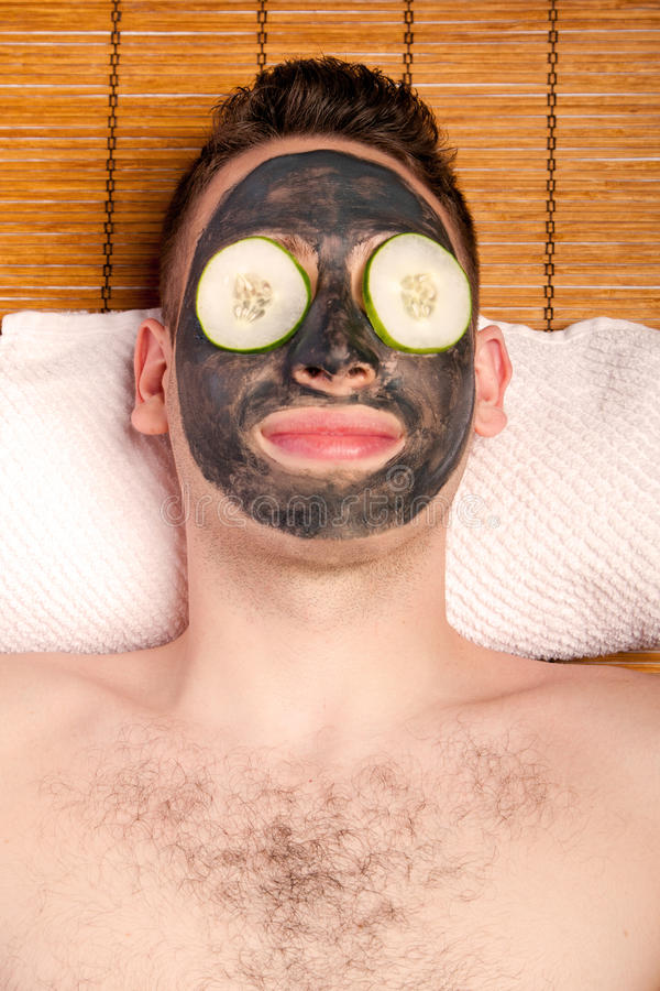 Male facial mask skincare stock photography