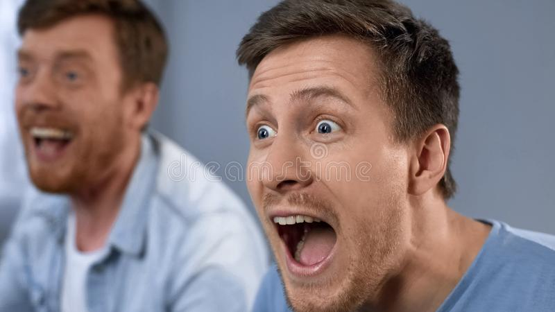 Male fans cheering together for favorite sports team, excitement, happiness. Stock photo stock photography