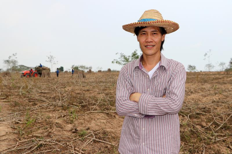 Male farmer standing and hugging chest in the cassava farm royalty free stock images