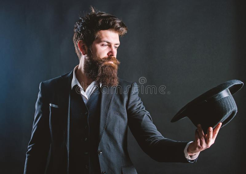 Male fashion and menswear. Formal suit classic style outfit. Elegant and stylish hipster. Retro fashion hat. Man with. Hat. Vintage fashion. Man well groomed royalty free stock image