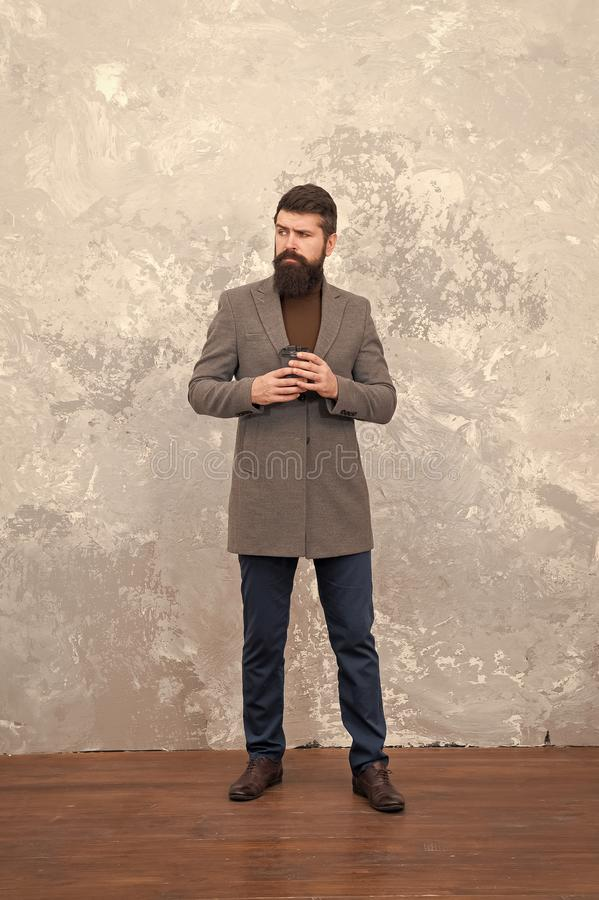 Male fashion model. Mature businessman drink coffee on go. trendy man with beard. Modern life. Casual style. Brutal stock images