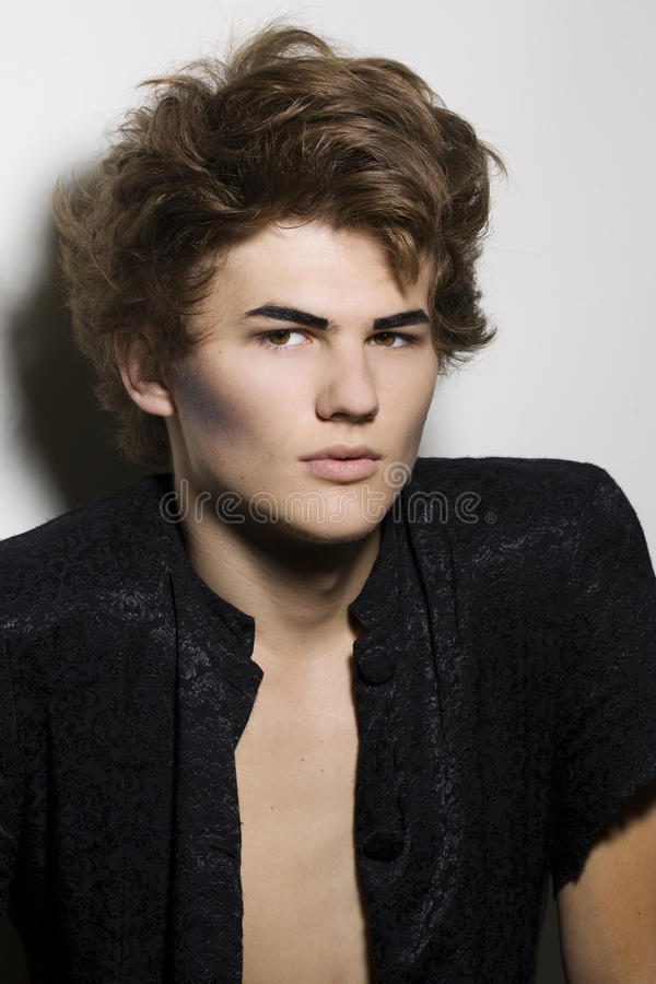 Male fashion model with stylish makeup stock photography