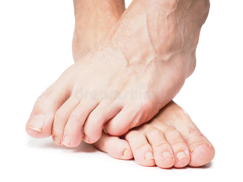 Male feet one over the other royalty free stock photography