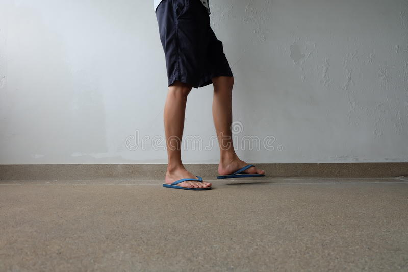 Male Feet Selfie Wearing Sandals Standing on Concrete Floor. Great For Any Use stock photography