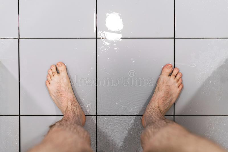 Male feet in shower. Concept of problem with potency. Man`s health. royalty free stock images