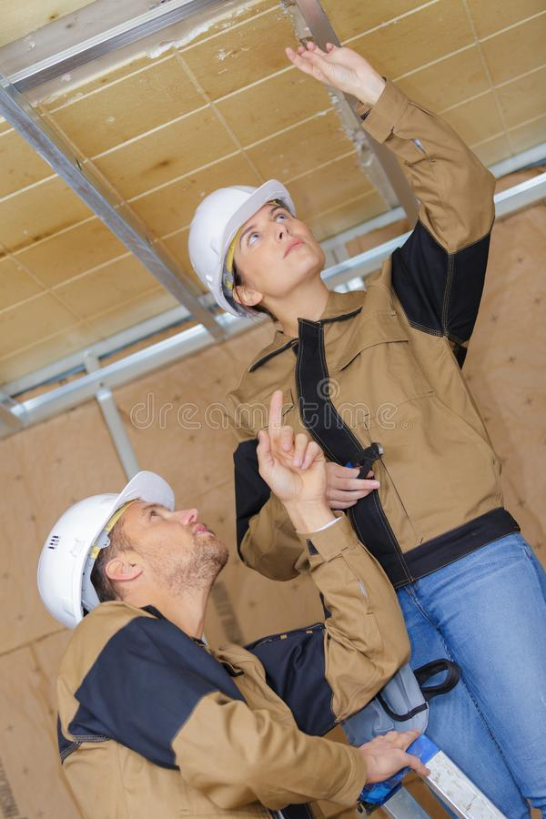 Male and female architects together at construction site stock photos