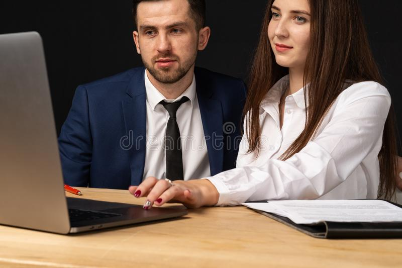 Male and female business partners collaborating on new startup stock photos