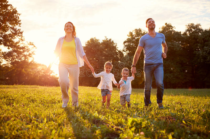 Male and female with children outdoor royalty free stock photography