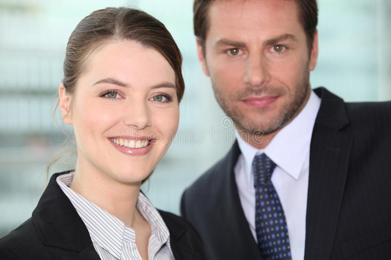Male and female colleagues royalty free stock photography