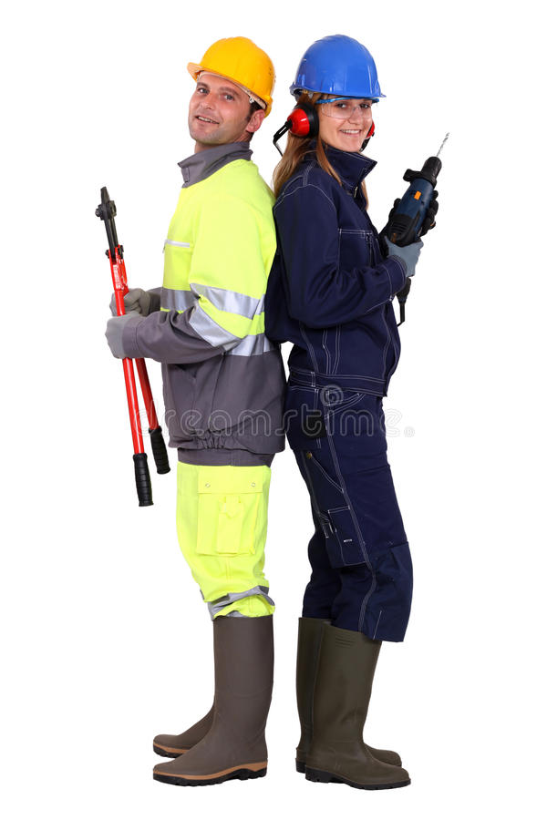 Male and female construction workers. Posing stock images