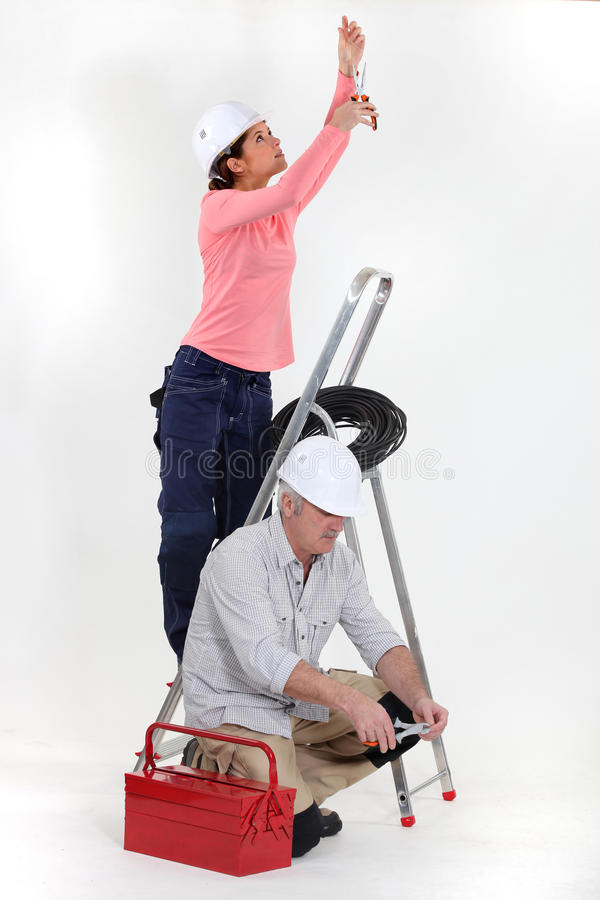 Male and female electricians royalty free stock photography
