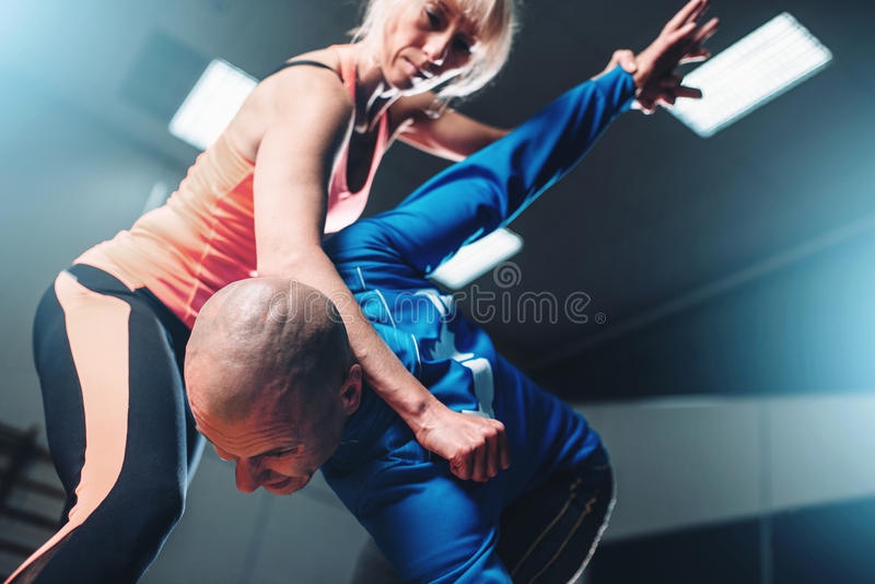 Male and female fighters, self-defense technique stock photo