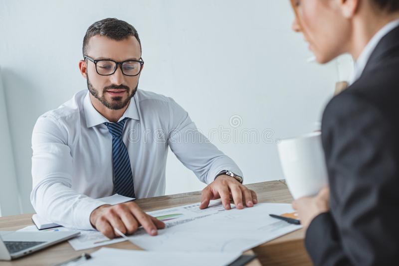 Male and female financiers working with documents. In office royalty free stock photos