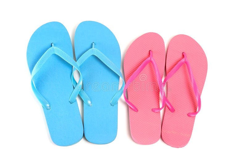 Male and female flip flops over white. Background royalty free stock photo