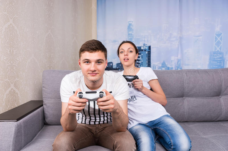 Male and female gamers playing video game stock images