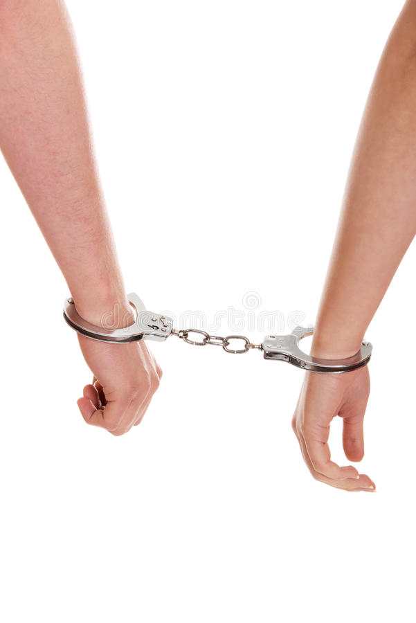 Male and female handcuffed. stock photo