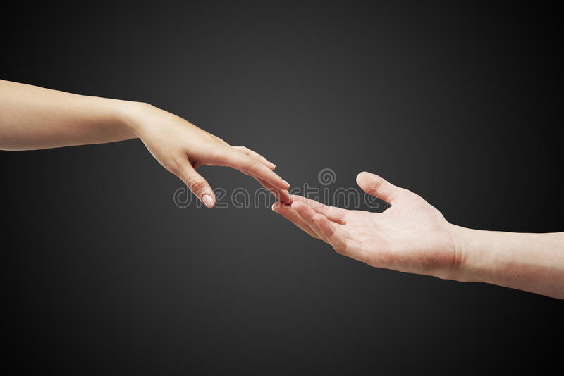 Male and female hands (palms) stretch to each oth royalty free stock photos