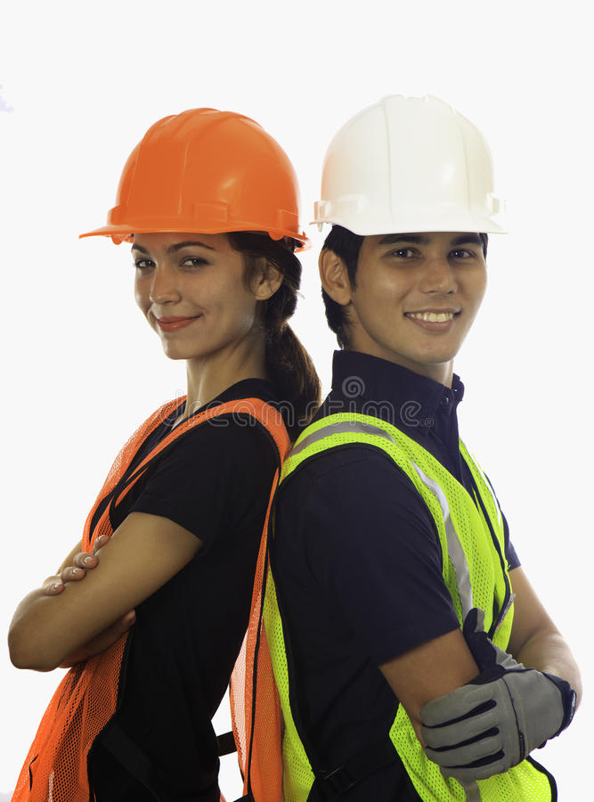 Male and female hardhat workers stock photo
