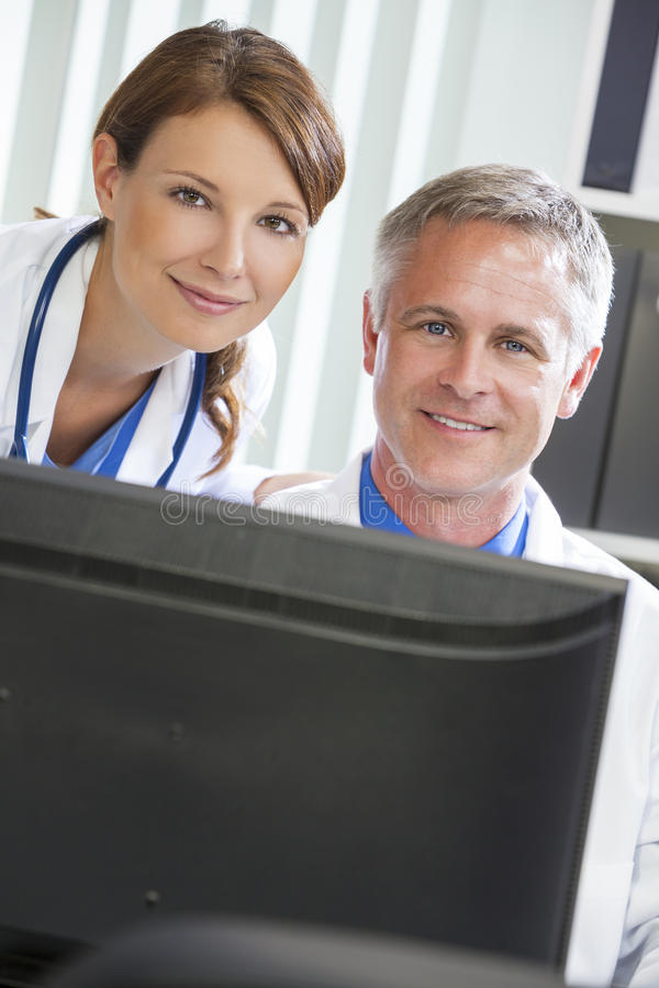 Male Female Hospital Doctors Using Computer Stock Photography