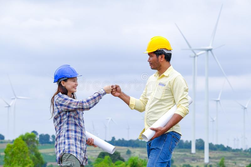Male and Female Industrial engineers are planning to develop wind power. personal protective equipment stock images