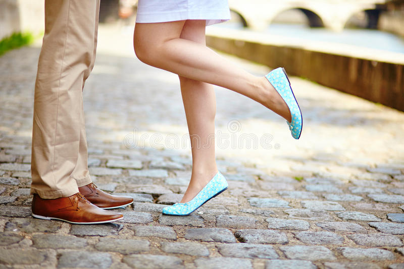 Male and female legs during a date stock photos