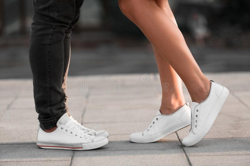 Male and female legs during date, couple kissing in city royalty free stock images
