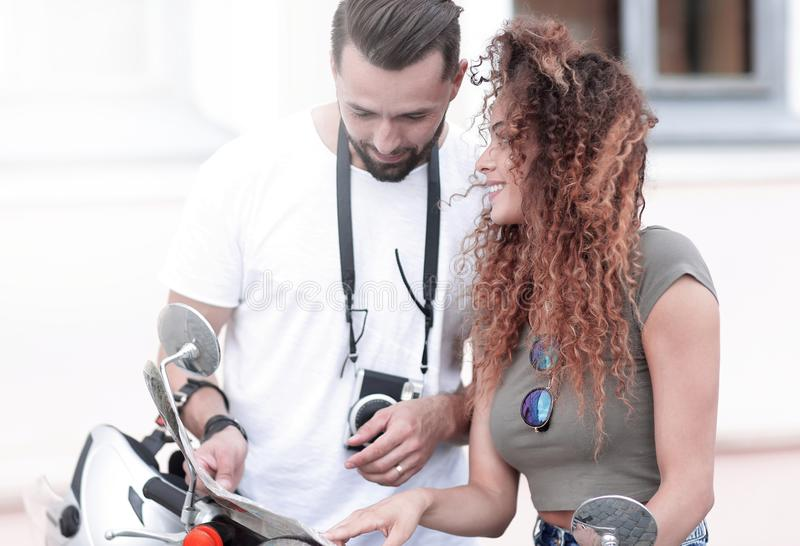 Scooter ride. Beautiful couple riding scooter together. stock photo