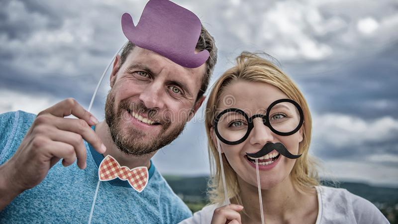 Male and female photo booth props on sky background. Party photo stock image