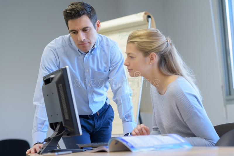 Male and female it programmers testing new software application royalty free stock photo